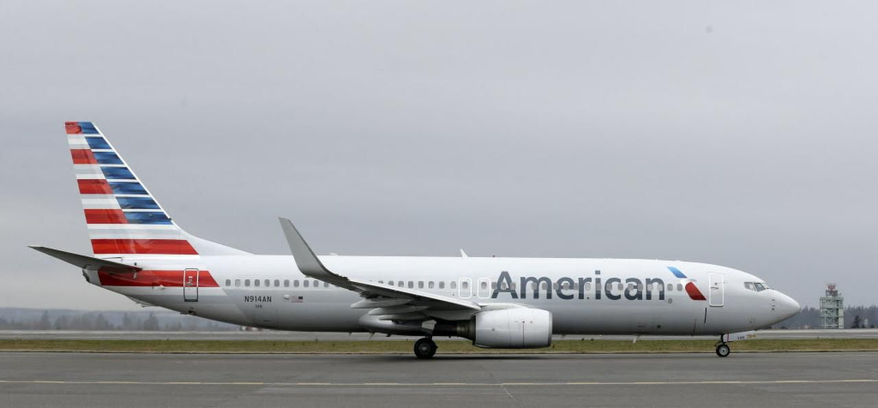 In this Tuesday, Jan. 26, 2016, photo, an American Airlines flight taxis at Seattle-Tacoma International Airport in Seattle. American reports financial results Friday, Jan. 29, 2016.