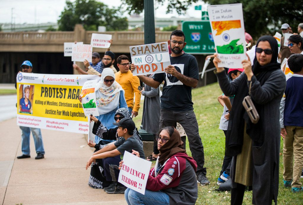 Demonstrators protested against the killing of Muslims in India on Sunday, July 14, 2019, at Dealey Plaza in Dallas.