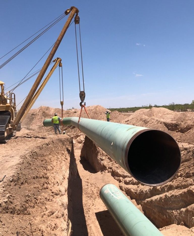 A shortage of crude oil and natural gas pipeline capacity is squeezing Permian Basin drillers. Kinder Morgan's $1.75 billion Gulf Coast Express natural gas pipeline — seen here in June 2018 in Midland County — is under construction and will link the Permian Basin with the Texas Gulf Coast. (Credit: Kinder Morgan)