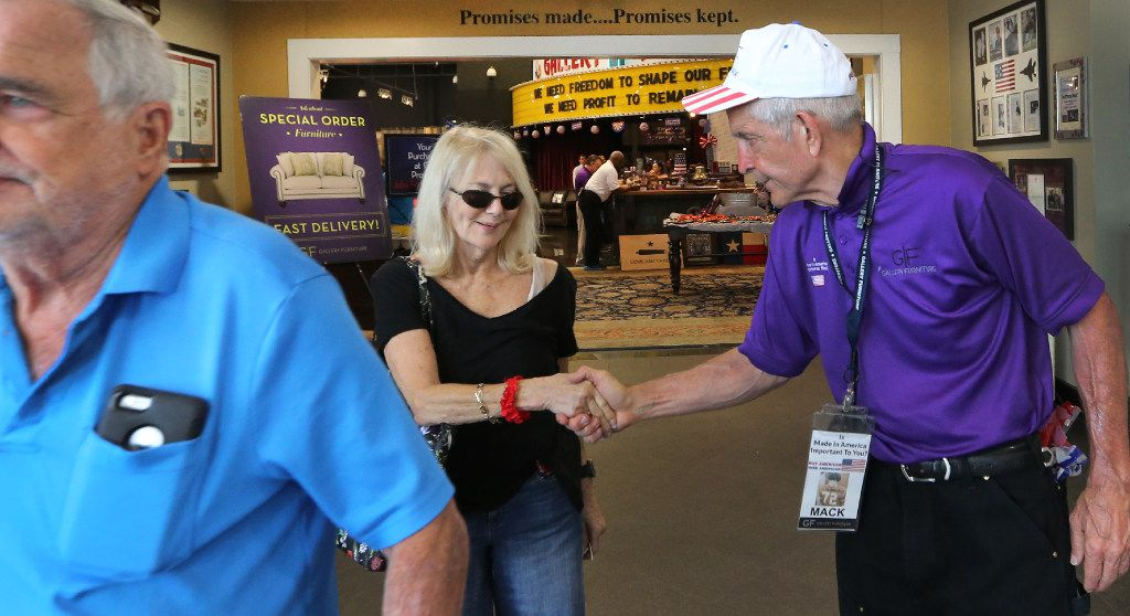 """Jim """"Mattress Mack"""" McIngvale, locally famous for philanthropy and his commercials for his business, Gallery Furniture, takes time to talk with customers at the store in north Houston on Sept. 11, 2017."""