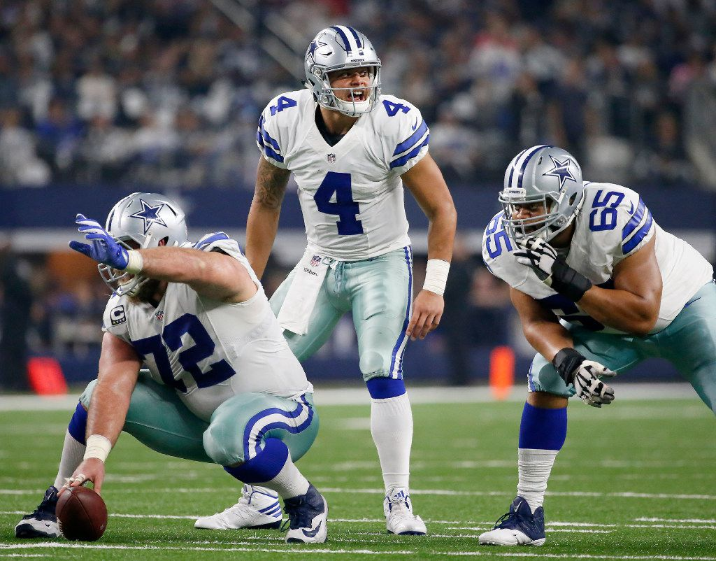 Dallas Cowboys quarterback Dak Prescott (4) yells behind center Travis Frederick (72) and guard Ronald Leary (65) during the fourth quarter against Green Bay Packers at AT&T Stadium in Arlington, Texas, Sunday, Jan. 15, 2017. The Dallas Cowboys lost 34-31. (Jae S. Lee/The Dallas Morning News)