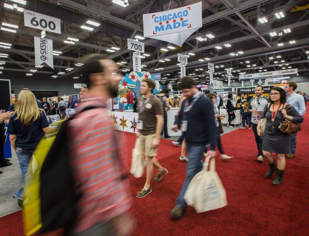 People make their way through a trade show at the Austin Convention Center during the 2015 SXSW interactive and film festival.