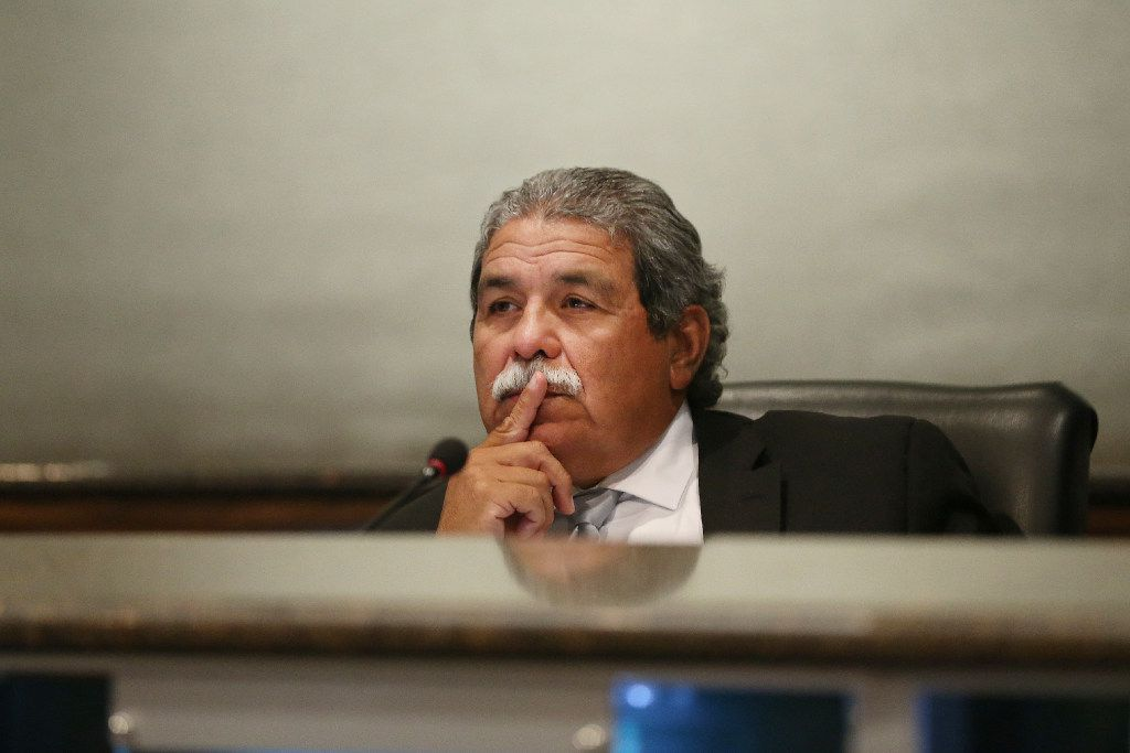 DISD Superintendent Michael Hinojosa listens during a public hearing and board meeting of the Dallas Independent School District at the Dallas ISD headquarters in Dallas on August 18, 2017.