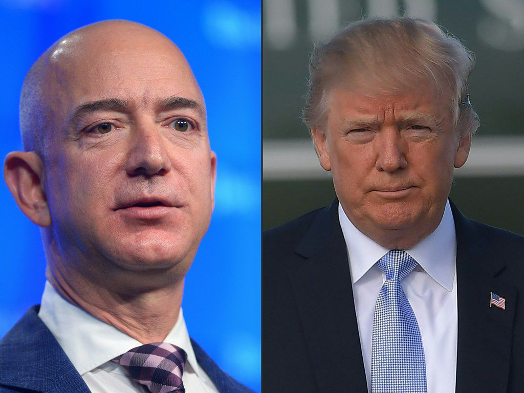 This combination of pictures created on March 29, 2018 shows a file photo taken on January 28, 2016, Washington Post owner Jeff Bezos speaking during the inauguration of the Washington Post Headquarters on January 28, 2016 in Washington, DC. A file photo taken on March 14, 2018 US President Donald Trump makes his way from Marine One to board Air Force One before departing from Los Angeles International Airport in Los Angeles on March 14, 2018.