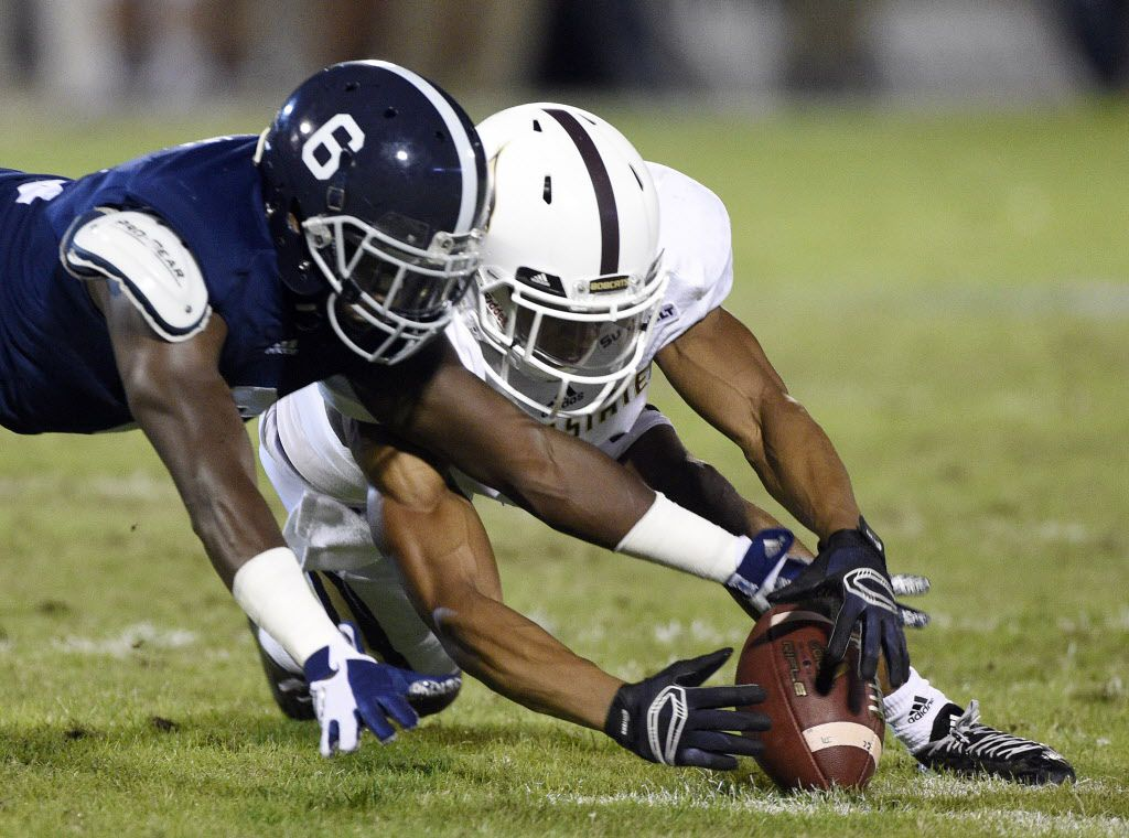 STATESBORO, GA - OCTOBER 29:  Cornerback Darrius White #6 of the Georgia Southern Eagles and wide receiver CJ Best of the Texas State Bobcats scramble for a loose ball during the second quarter on October 29, 2015 at Paulson Stadium in Statesboro, Georgia.  (Photo by Todd Bennett/GettyImages)