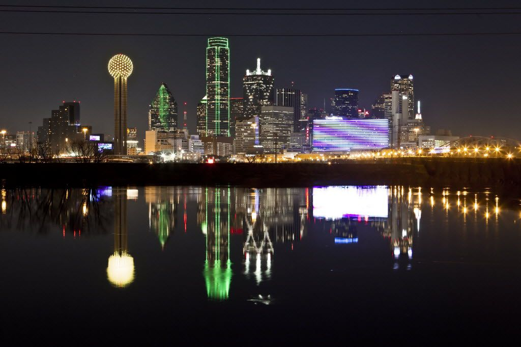 In this  Jan. 26, 2012 file photo, the Dallas skyline is reflected in the Trinity River.