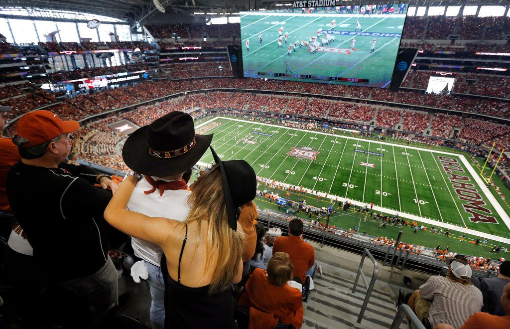 A Texas Longhorn couple embrace during the Big XII Championship game at AT&T Stadium in Arlington, Texas, Saturday, December 1, 2018. (Tom Fox/The Dallas Morning News)