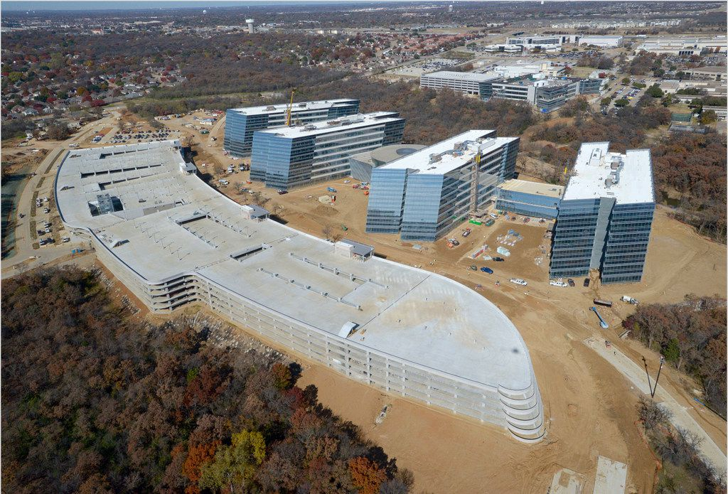"Construction of the new American Airlines ""Trinity Complex"" headquarters located near Hwy 360 and Hwy 183 close to DFW airport, shown Nov. 28, 2018 in a drone photo provided by American Airlines. The five-building office complex is under construction off Trinity Boulevard in Fort Worth and is expected to house more than 7,000 administrative employees. It will join a 300-acre campus that already includes many of American's training and operations facilities, including its flight academy, integrated operations center, reservations center, and training and conference center."