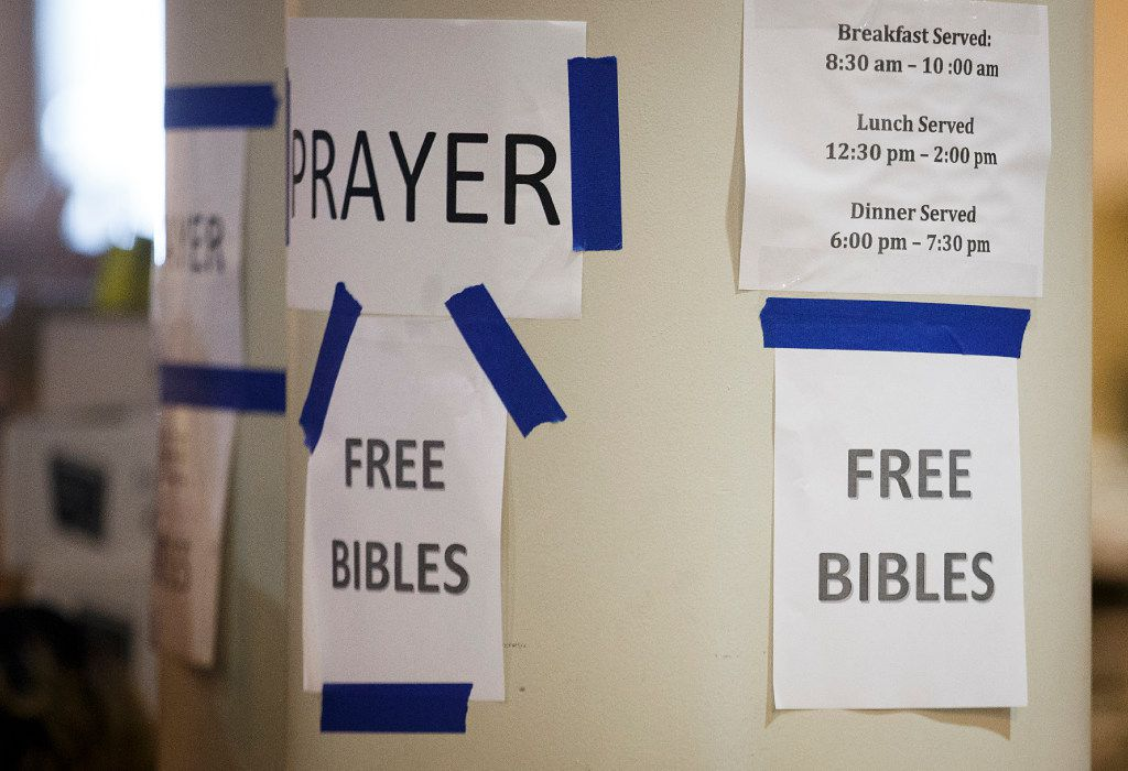 Signs for free bibles and prayer in a section of the NRG Center evacuation center for Hurricane Harvey evacuees on Monday, Sept. 4, 2017, in Houston.