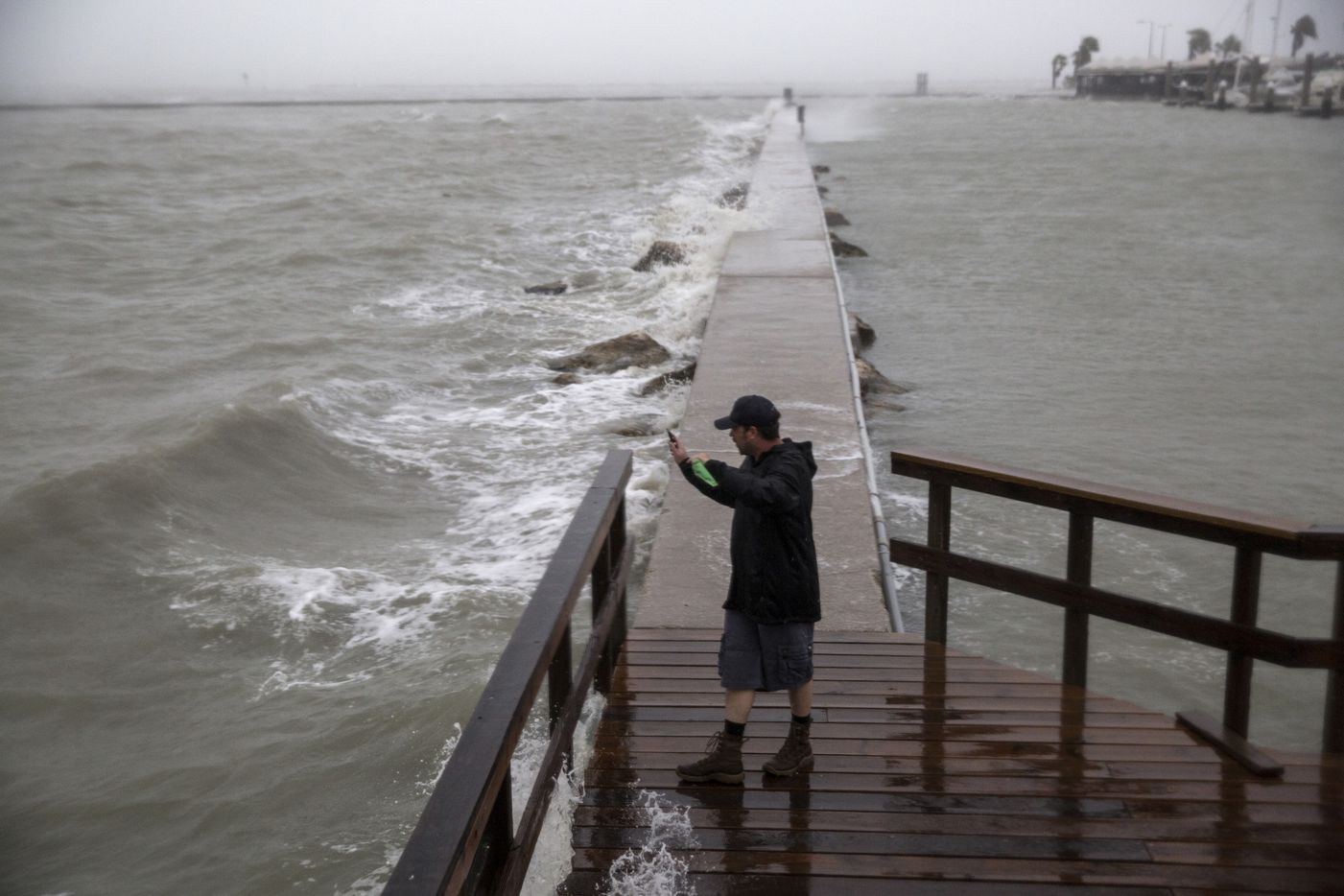 Jason Weingart, a storm chaser working for the Weather Channel, livestreams the effects of Hurricane Harvey in Corpus Christi, Texas, Aug. 25, 2017. Harvey strengthened to a Category 4 storm on Friday evening as it approached the Texas Gulf Coast.