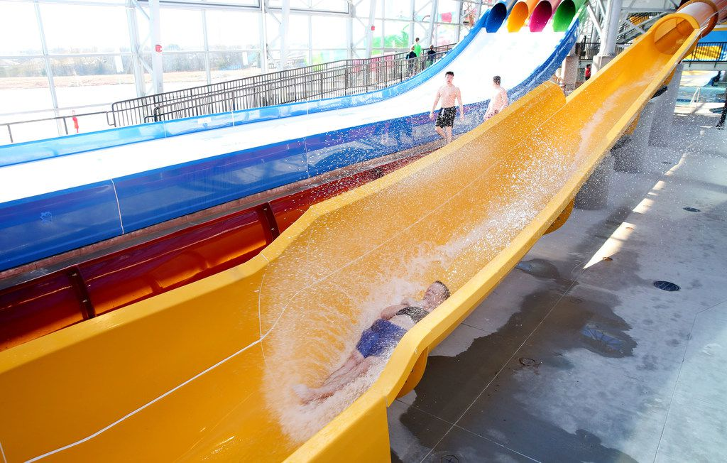 John Akin goes down a water slide during a media day at the new Epic Waters Indoor Waterpark in Grand Prairie, Texas on Monday, Jan. 8, 2018. The city-owned waterpark is the largest in North America under a single retractable roof. (Rose Baca/The Dallas Morning News)