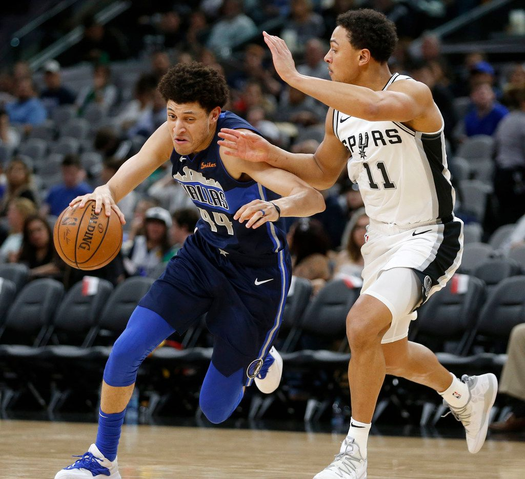 Dallas Mavericks forward Justin Jackson (44) drives around San Antonio Spurs guard Bryn Forbes (11) during the second half of play at AT&T Center in San Antonio, Texas on Wednesday, April 10, 2019. (Vernon Bryant/The Dallas Morning News)