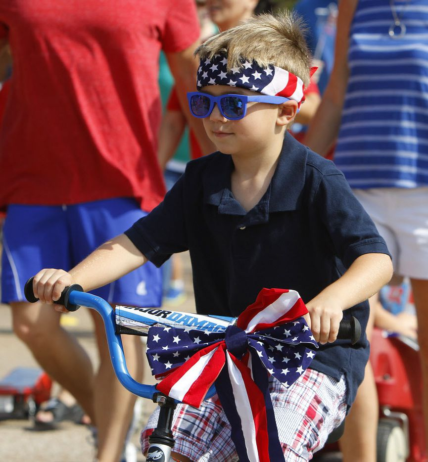Addison Weaver, 4, rides in the Independence Fest Children's Parade in Flower Mound, Texas on Saturday, July, 4, 2015.