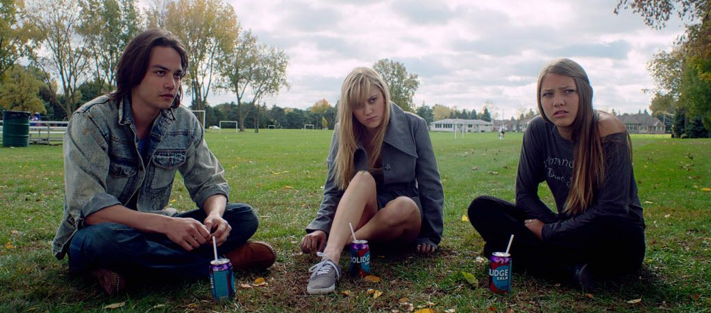 Daniel Zovatto, Maika Monroe (center) and Lili Sepe star in It Follows,  an intelligent film that plays with notions of sex.