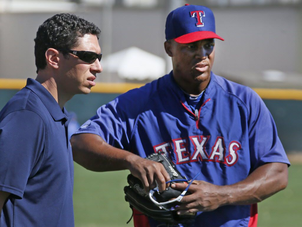 Texas general manager Jon Daniels talks with third baseman Adrian Beltre before the Cleveland Indians vs. the Texas Rangers spring training baseball game at Surprise Stadium in Surprise, AZ  on Monday, March 3, 2014.  (Louis DeLuca/Dallas Morning News)