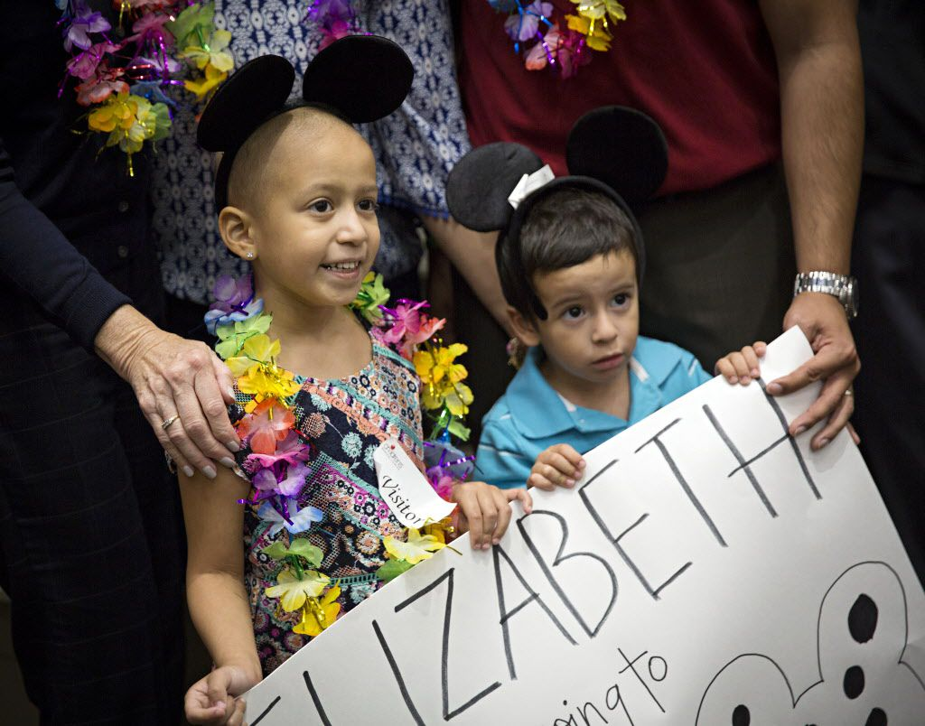 Elizabeth Flores (left) and her brother, Esteban, pose for photos after Elizabeth was told her Make-A-Wish was granted during a ceremony at Children's Medical Center Dallas Tuesday, October 18, 2016 in Dallas. Flores, a five-year-old with Leukemia, was one of five patients at the hospital who were granted their wishes. (G.J. McCarthy/The Dallas Morning News)