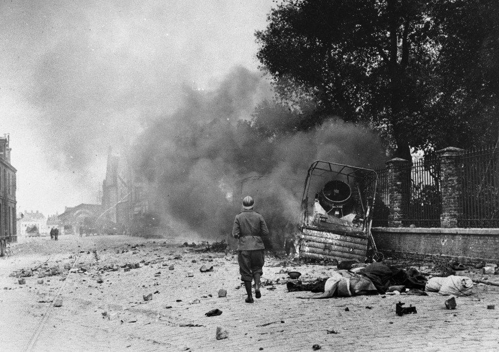 Smoke and debris in a street of Dunkirk, France, showing the effects of bombardment, June 1940. (File Photo/The Associated Press)