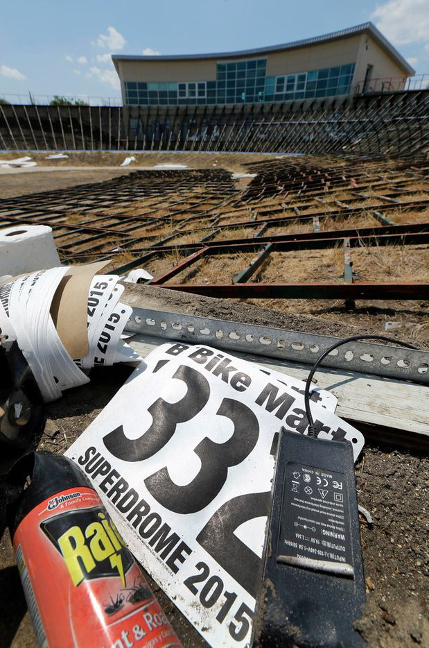 Remains from the Frisco Superdrome lie scattered on the infield on Saturday, Aug. 4. The track, which used to host Olympic trials, has been on the decline the last several years, and the city recently decided it wasn't worth paying to have the surface refinished. Collin College wants the land for something else.
