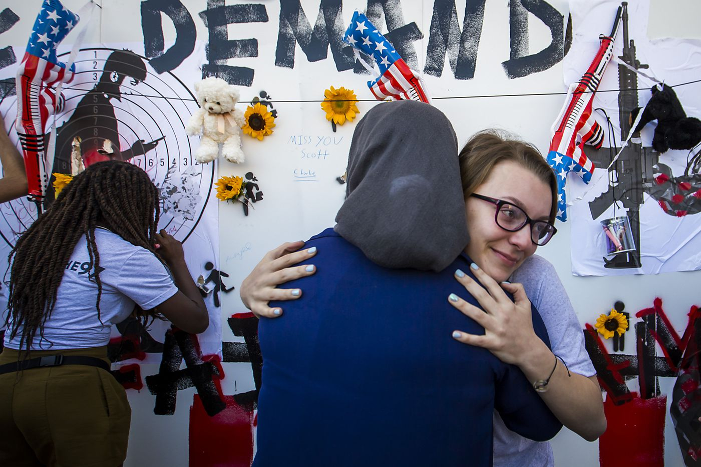 Sophie Conde, facing, hugs Waed Alhayek after Alhayek spoke during a gun control demonstration outside Dallas City Hall organized by StudentsMarch.org during the NRA Annual Meeting & Exhibits at the Kay Bailey Hutchison Convention Center on Saturday, May 5, 2018, in Dallas.