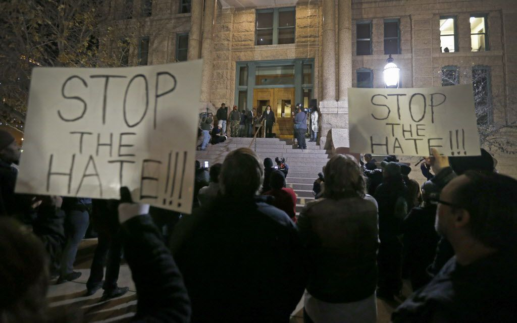 People gather to protest against police brutality at Tarrant County Courthouse in downtown Fort Worth, Texas, Thursday, Dec. 22, 2016.