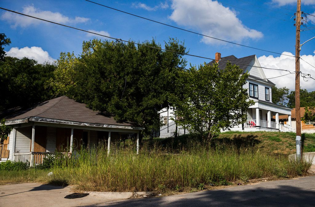 """At left is the house at 1105 E. 9th Street that the Landmark Commission refused to vote to demolish, despite a city ordinance that says they """"shall"""" do that very thing if there's a court order to raze the structure."""
