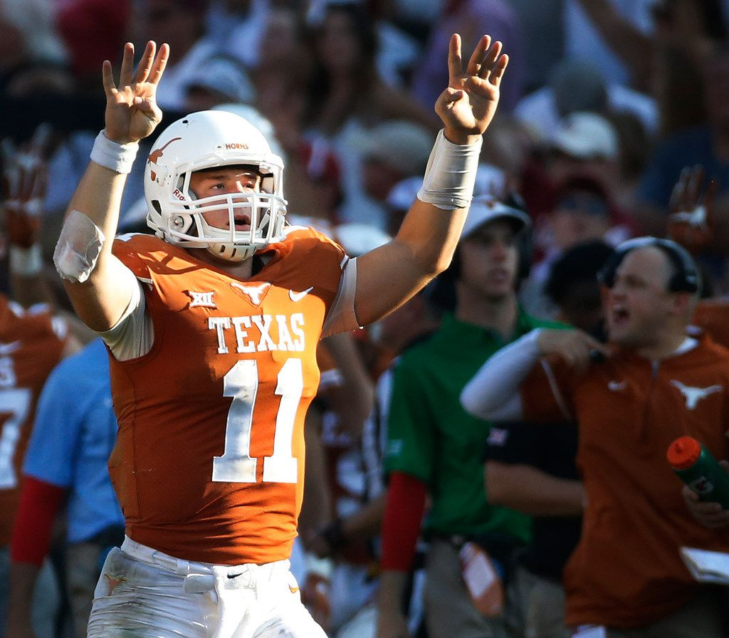 FILE - Texas quarterback Sam Ehlinger (11) is pictured during the Red River Showdown against Oklahoma at the Cotton Bowl in Dallas on Saturday, Oct. 14, 2017. (Louis DeLuca/The Dallas Morning News)