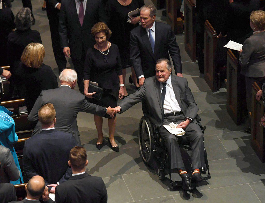 TOPSHOT - Former US President George H.W. Bush exits the funeral of his wife First Lady Barbara Bush, followed by his daughter-in-law former First Lady Laura Bush and former President George W. Bush at St. Martin's Episcopal Church in Houston, Texas, on April 21, 2018. / AFP PHOTO / POOL / Jack GruberJACK GRUBER/AFP/Getty Images
