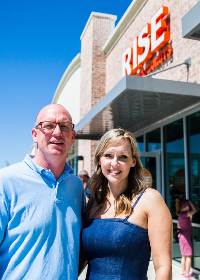 Rise Biscuits Donuts owners Dax and Brandy Ferguson pose for a photo outside their new location during a grand opening event on Thursday, March 30, 2017 in Allen, Texas. (Ashley Landis/The Dallas Morning News)