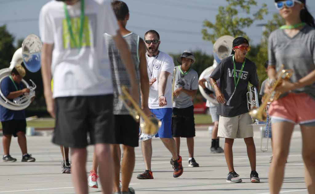 Assistant band director Matthew Schaul helped lead marching band practice in early August at Lebanon Trail High School in Frisco.