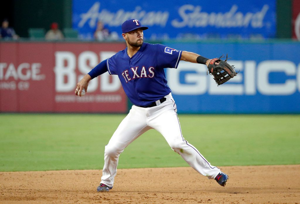 Texas Rangers third baseman Isiah Kiner-Falefa (9) throws to first during a baseball game against the Minnesota Twins in Arlington, Texas, Friday, Aug. 16, 2019. (AP Photo/Tony Gutierrez)