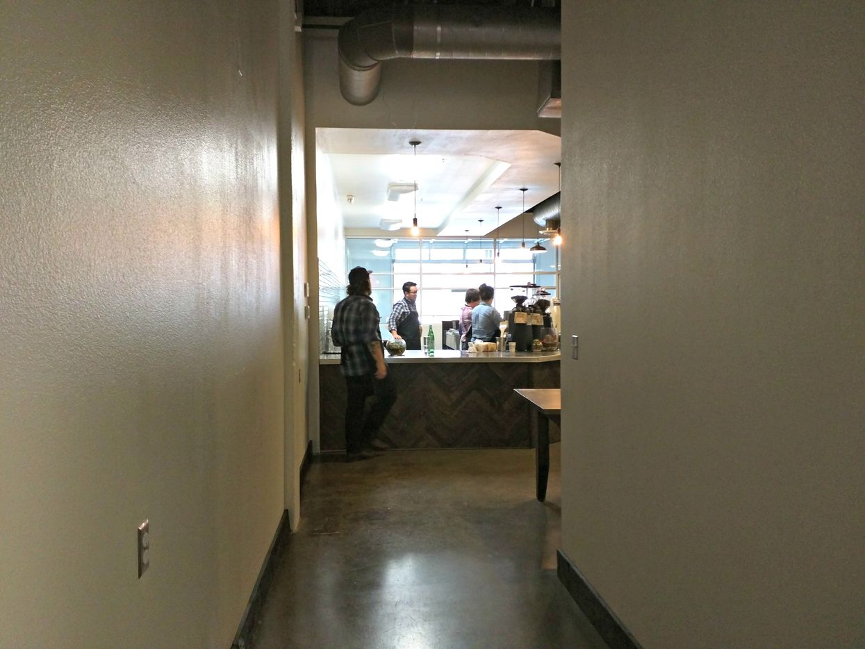 Customers enter down a long hallway, which will be outfitted with bars and ample outlets for those wishing to get a bit of work done.