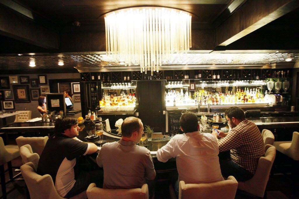 Men sit at the bar inside the Bowen House bar and restaurant in Uptown Dallas.  (Ben Torres/Special Contributor)