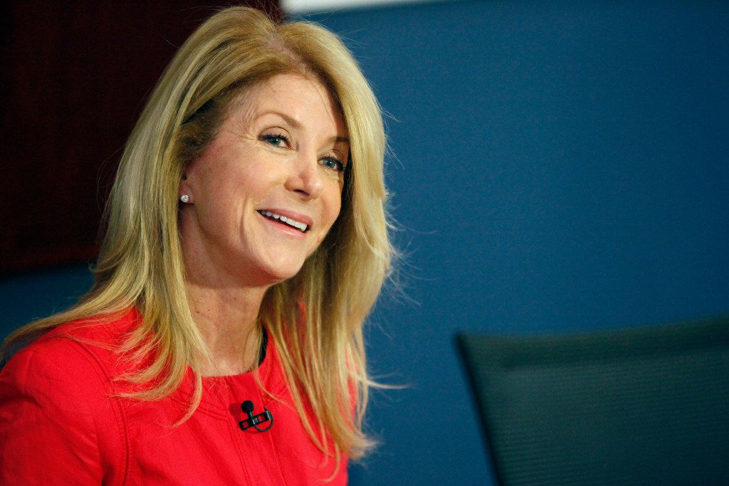 Wendy Davis, former Texas state senator and 2014 candidate for Texas governor, answers a question from a member of the press before speaking at the 52nd Annual Southern Methodist University Women's Symposium in March 2017.
