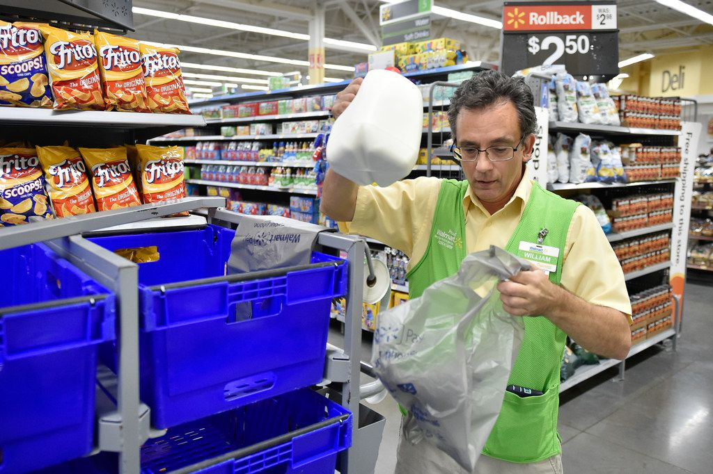 File photo of Wille Pierson preparing a customer's order for pick-up at the Walmart Neighborhood Market in Denton, Texas, Jeff Woo/DRC