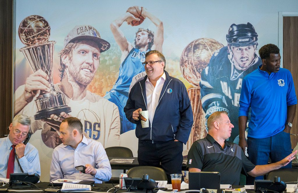 Dallas Mavericks president Donnie Nelson (center) in the draft room at American Airlines Center before the NBA draft, with (from left) assistant general manager Keith Grant, director of scouting Jason White, director of player personnel Tony Ronzone and vice president of basketball operations Michael Finley on Thursday, June 20, 2019, in Dallas. (Smiley N. Pool/The Dallas Morning News)