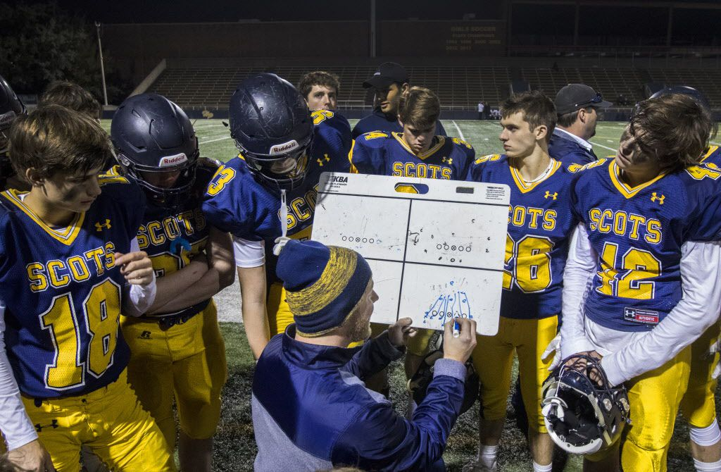 Coach Stephen Byrd talks to players during the first half of the junior varsity high school football game between Highland Park and Mansfield at Highlander Stadium in Dallas, Texas on Nov. 7, 2018. (Carly Geraci/The Dallas Morning News)