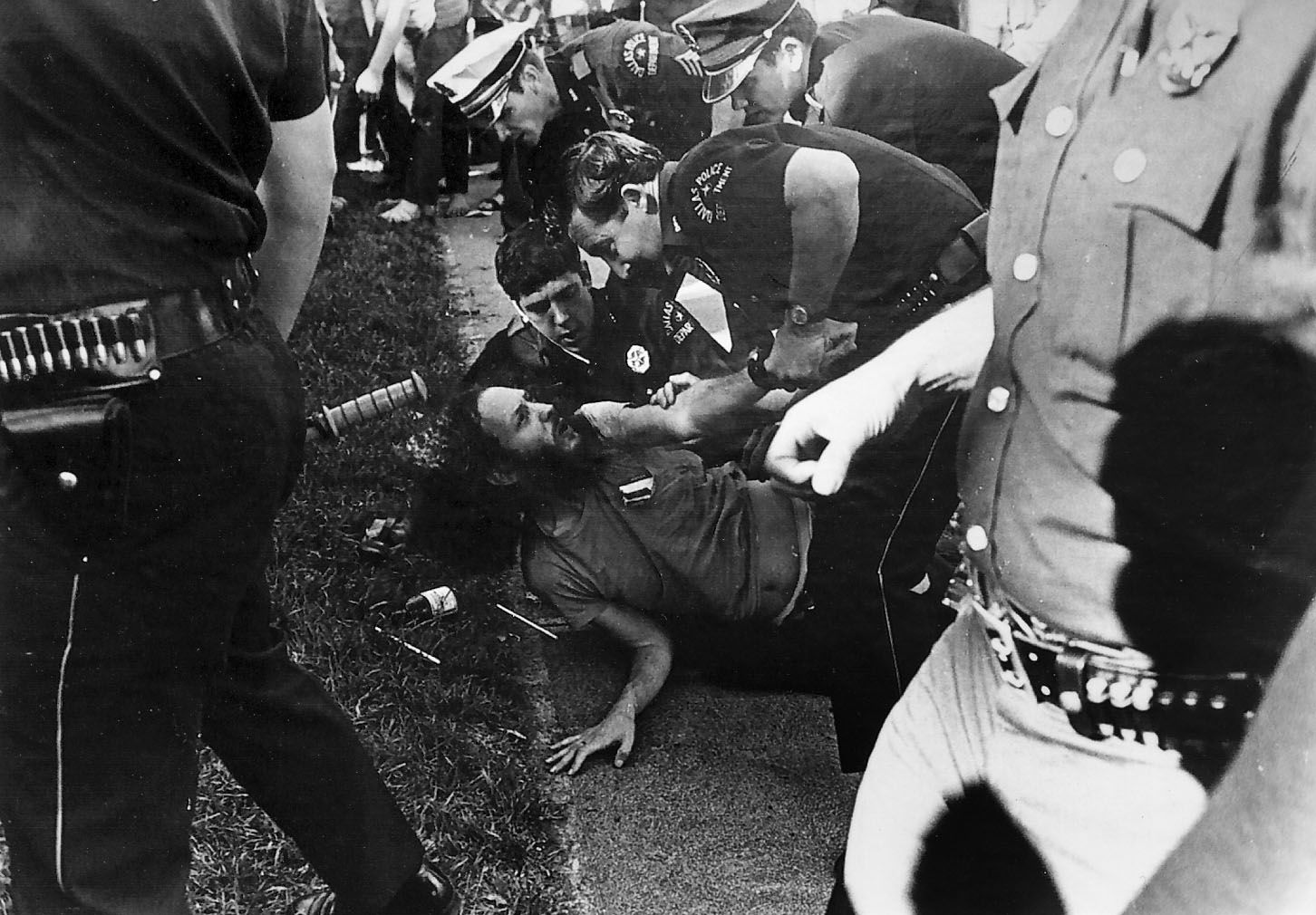"""Brent Stein, a.k.a. """"Stoney Burns,"""" is arrested April 12, 1970 by Dallas Police officers at Lee Park. The Dallas Morning News at the time reported that """"a clash between law officers and young people occurred when police tried to arrest several hippie-types"""" at the park."""
