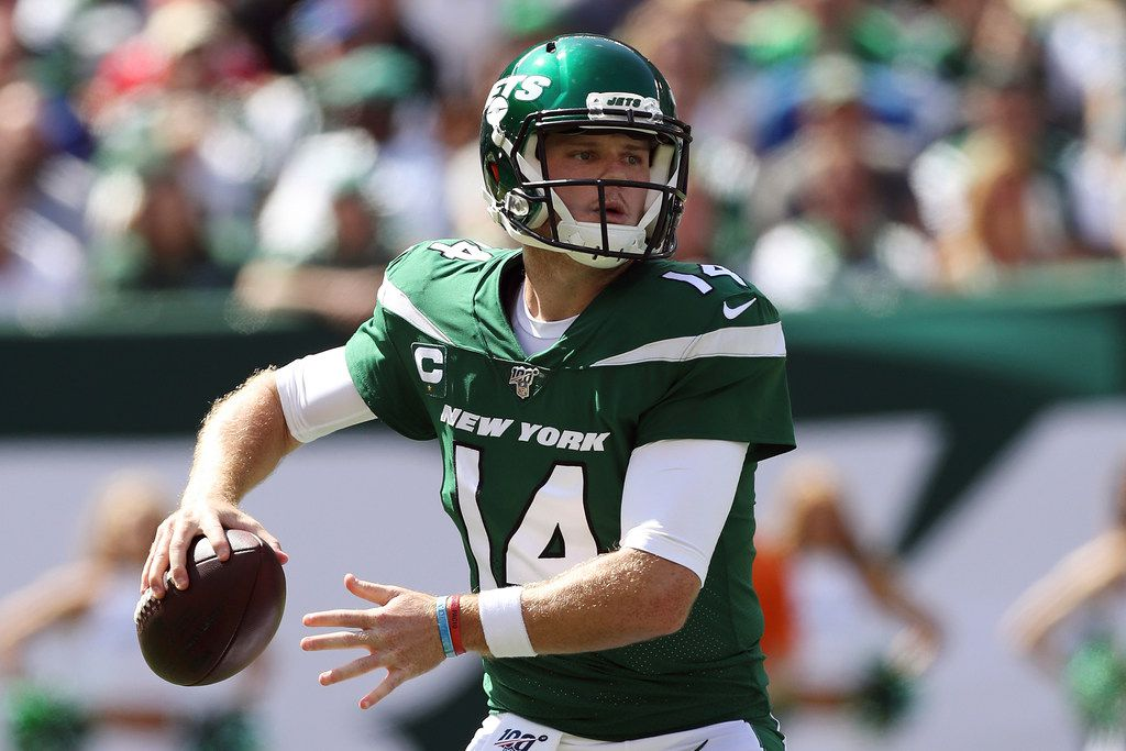 FILE - In this Sept. 8, 2019, file photo, New York Jets quarterback Sam Darnold (14) makes a pass during an NFL football game against the Buffalo Bills, in East Rutherford, N.J. Jets quarterback Sam Darnold was uncertain to return this week as he continued to recover from mononucleosis, which sidelined him the past two games. Jets coach Adam Gase said the team could potentially wait until Sunday to decide if Darnold or practice squad QB-turned-starter Luke Falk will be under center against the Eagles.