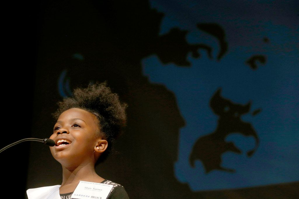 Fourth grader, Skye Dakota Turner of the Charles Rice Learning Center speaks gives her speech in the 26th Annual Gardere MLK Jr. Oratory Competition at W.H. Adamson High School in Dallas on Friday, January 12, 2018. (Vernon Bryant/The Dallas Morning News)