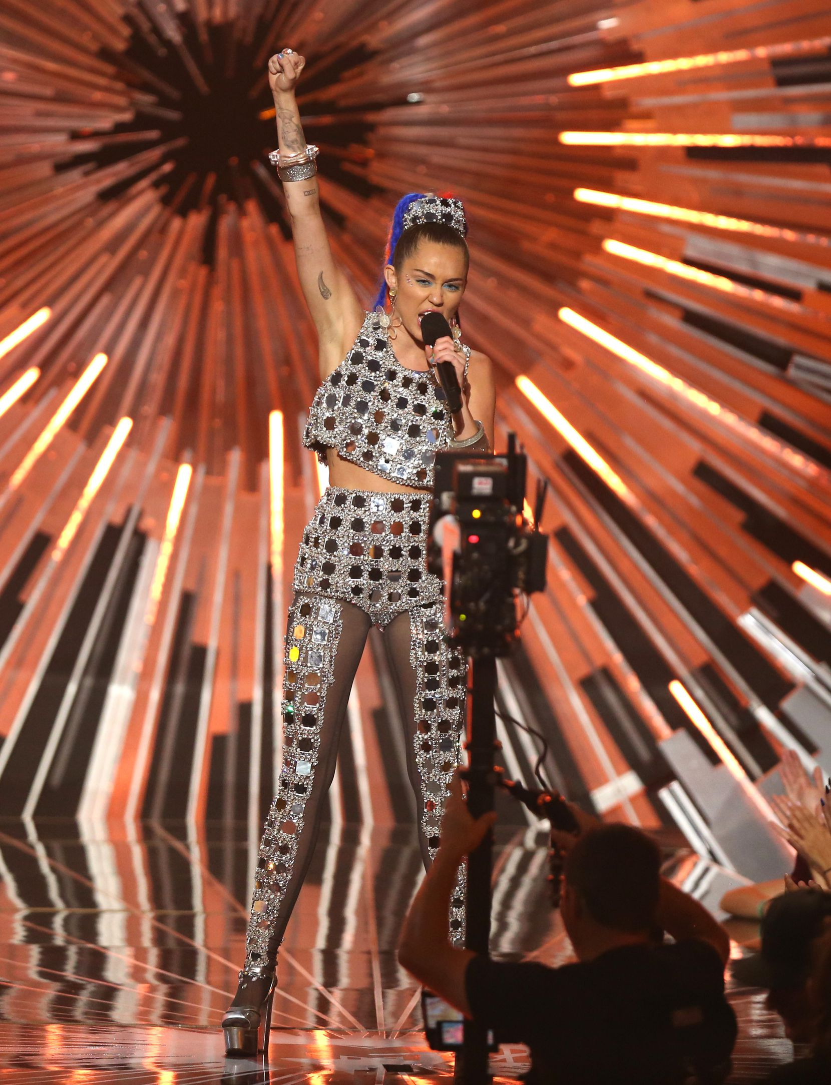 Host Miley Cyrus speaks at the MTV Video Music Awards at the Microsoft Theater on Sunday, Aug. 30, 2015, in Los Angeles.