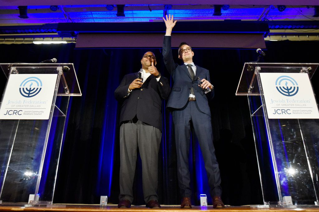 Dallas mayoral candidates Eric Johnson (left) and Scott Griggs acknowledge the audience after a forum hosted by the Jewish Community Relations Council of the Jewish Federation of Greater Dallas.