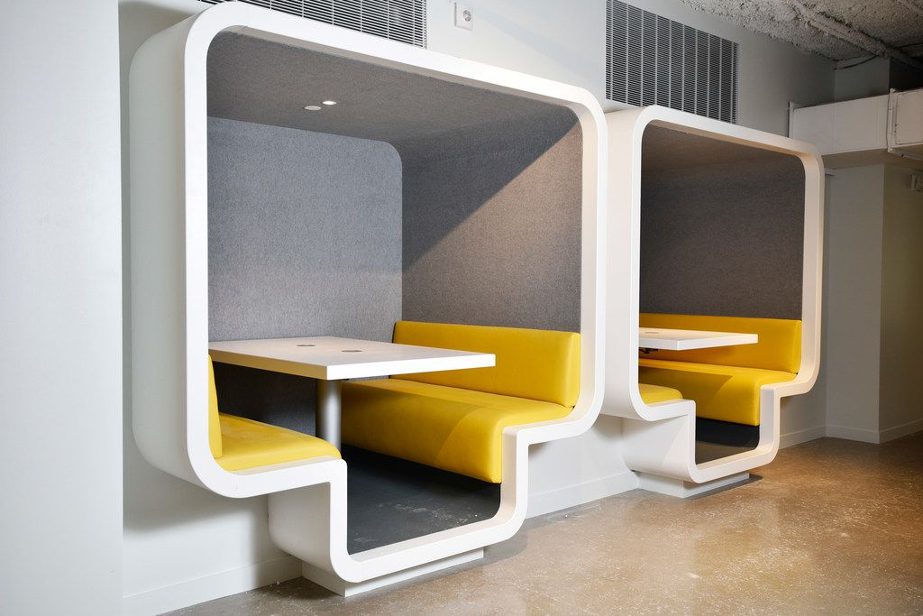 Worktables will be large enough to accommodate laptops and fitted with pop-up outlets.
