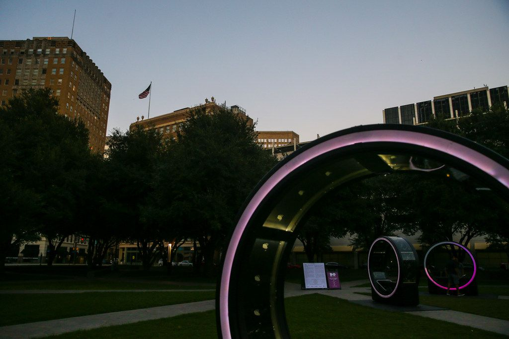 "Rings are illuminated at dusk for the ""Loop"" interactive art display at Burnett Park in Fort Worth."