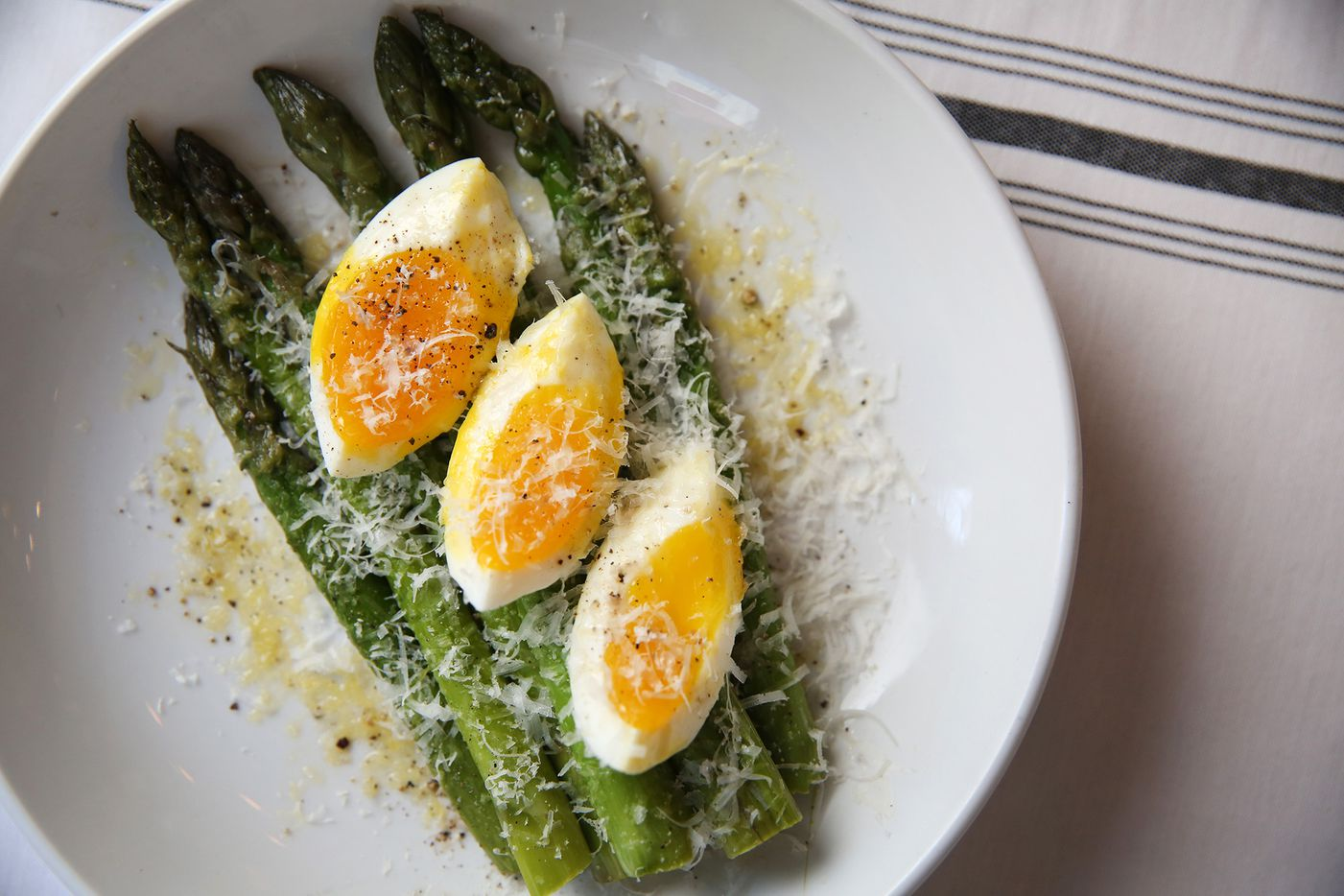 Asparagus milanese, shown May 17, is a featured dish at Piattello Italian Kitchen in Fort Worth.
