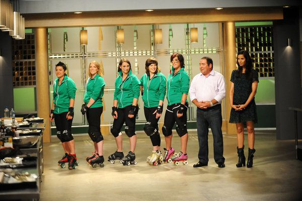 """The Rat City Rollergirls are """"one of the hottest sports teams in Seattle,"""" and they were the subject of the elimination challenge this week on """"Top Chef: Seattle."""" They're seen here with Emeril Lagasse and Padma Lakshmi."""