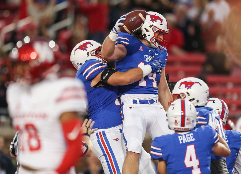 Southern Methodist Mustangs tight end Ryan Becker (14) celebrates a touchdown during a matchup between the Southern Methodist Mustangs and the Houston Cougars on Saturday, Nov. 3, 2018 at Ford Stadium in Dallas. (Ryan Michalesko/The Dallas Morning News)