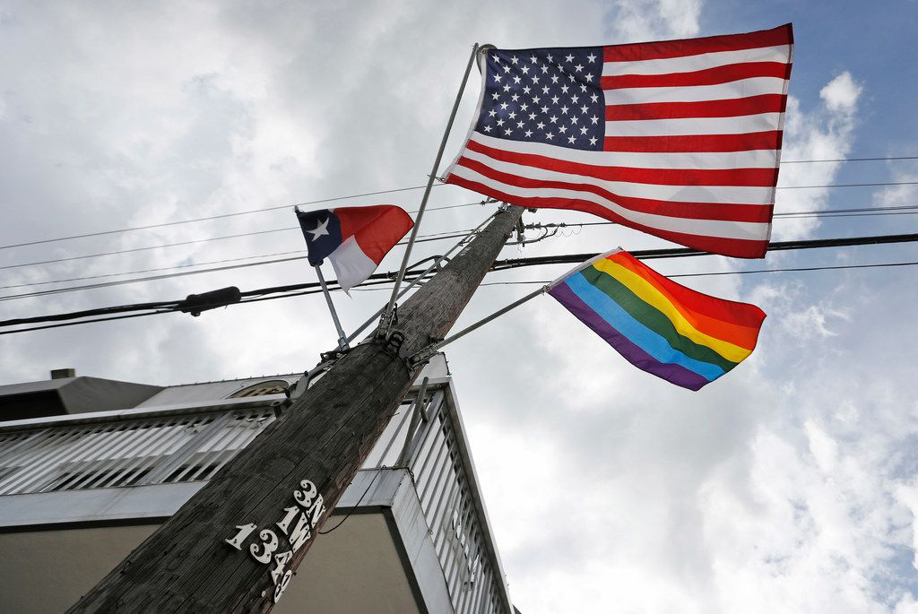 An LGBT flag flies at the intersection of Cedar Springs Road and Throckmorton Street in Dallas.