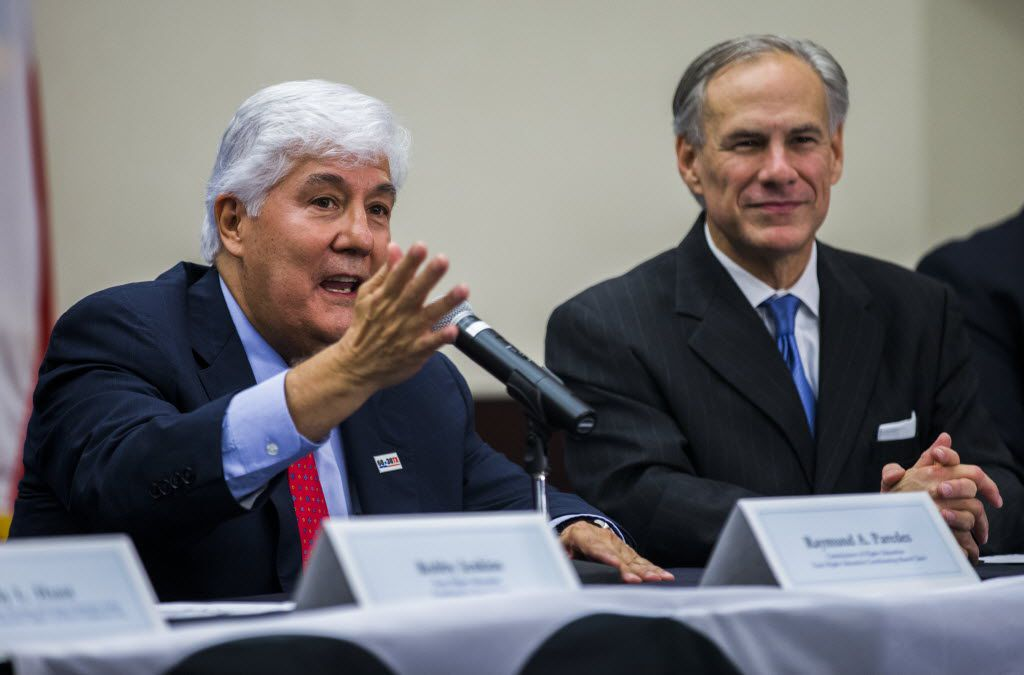 Raymund A. Paredes (left), commissioner of Higher Education and Texas Higher Education Coordinating Board chair, speaks after Gov. Greg Abbott announced the launch of the Texas Higher Education Coordinating Board's 60 x 30TX plan on Monday, Nov. 16, 2015, at Collin College Higher Education Center in McKinney.