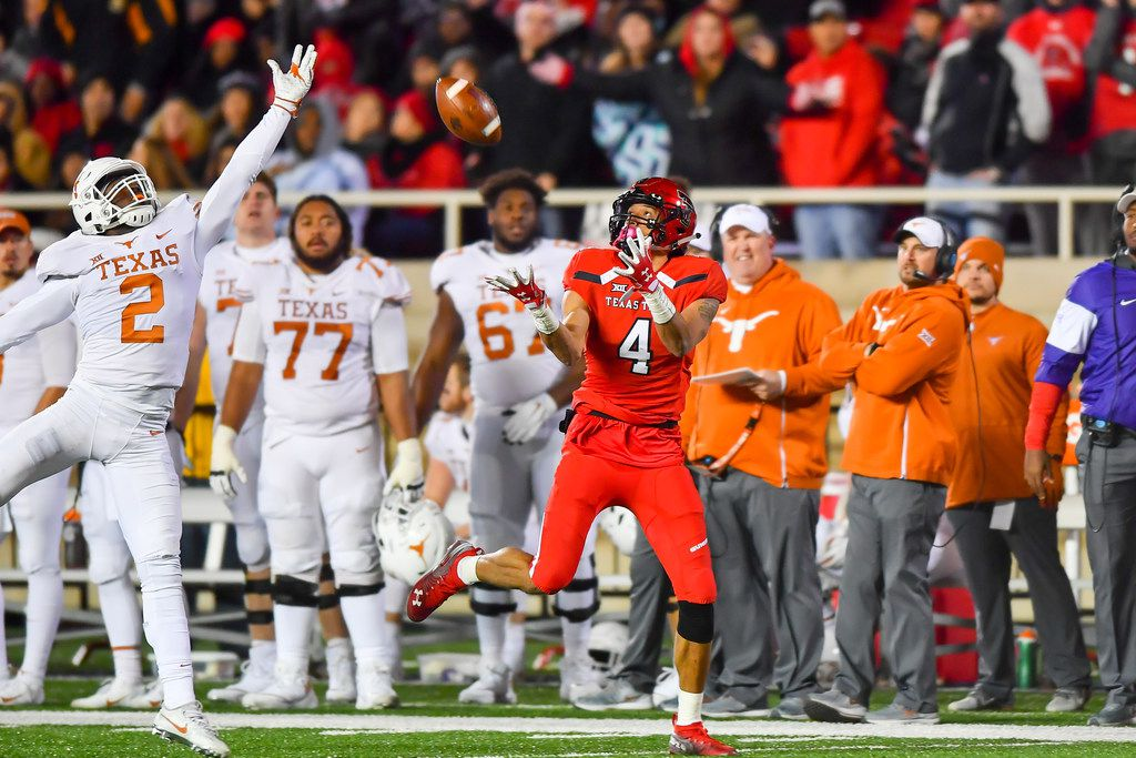 LUBBOCK, TX - NOVEMBER 10: Antoine Wesley #4 of the Texas Tech Red Raiders will make the catch against Kris Boyd #2 of the Texas Longhorns during the 2nd half of the game on November 10, 2018 at Jones AT&T Stadium in Lubbock, Texas. Texas defeated Texas Tech 41-34. (Photo by John Weast/Getty Images)