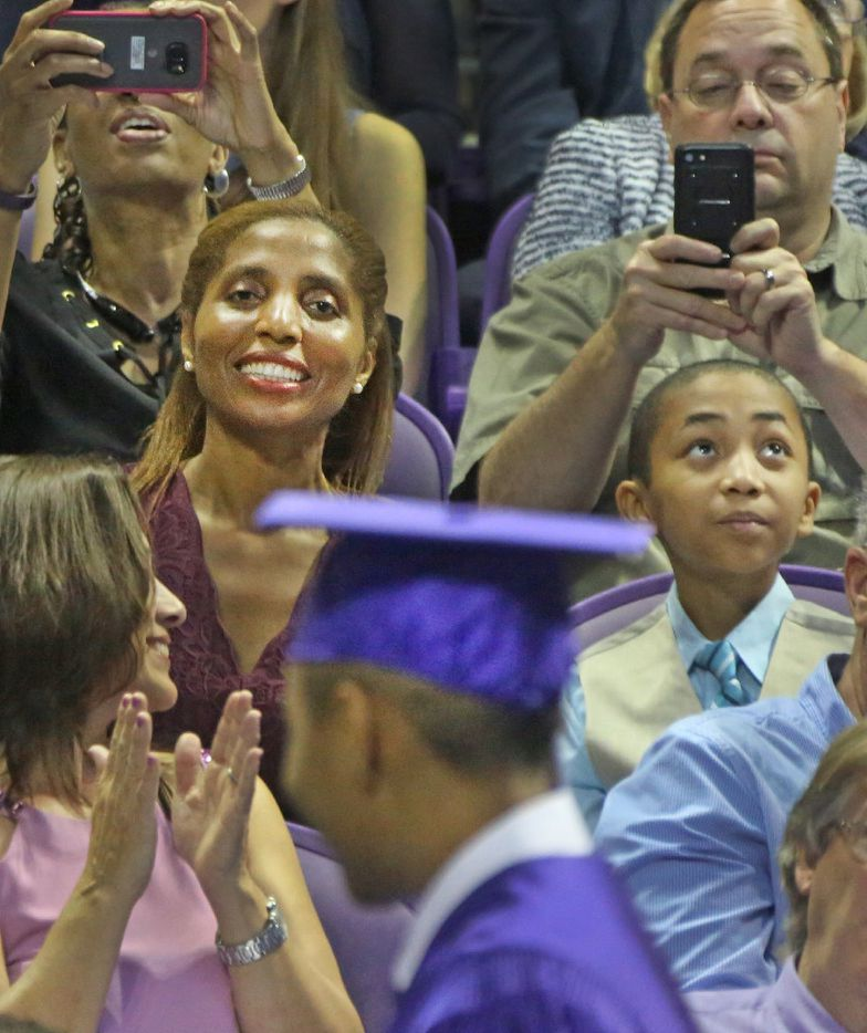 14-year-old Carson Huey-You's mother Claretta is all smiles as she sees her son getting ready to get his diploma at TCU. (Louis DeLuca/Dallas Morning News)